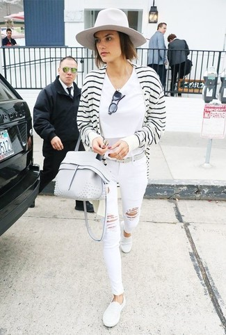 A white and black striped open cardigan and white ripped skinny jeans are a great outfit formula to have in your arsenal. A pair of white slip-on sneakers will integrate smoothly within a variety of combos. So as you can see here, it's a cute, not to mention spring-appropriate, combo to keep in your seasonal rotation.