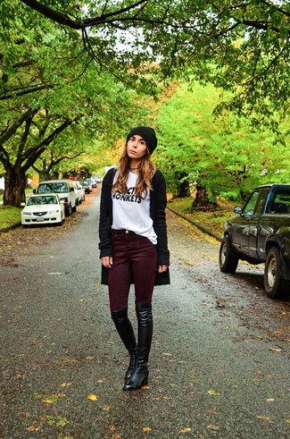 Dark Purple Skinny Jeans Outfits: Consider wearing a black open cardigan and dark purple skinny jeans to achieve a totaly stylish and current relaxed casual outfit. A pair of black leather over the knee boots will bring a hint of sultry class to this ensemble.