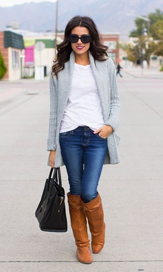 If it's comfort and practicality that you're seeking in an outfit, consider teaming a grey knit open cardigan with blue skinny jeans. Why not introduce Salvatore Ferragamo Knee Length Boots to the mix for an added touch of style? A wonderful example of transitional style, this outfit is a staple this spring.