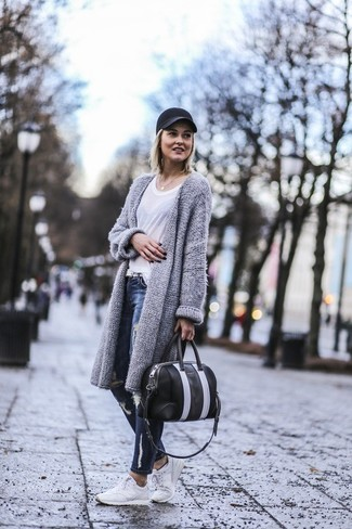 Stand out among other stylish civilians in a grey knit open cardigan and dark blue distressed skinny jeans. Want to go easy on the shoe front? Throw in a pair of white trainers for the day.