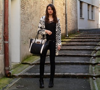 Dress in an Alice + Olivia Alice Olivia Jenny Cropped Lace Paneled Velvet Top Black and black skinny jeans for an effortless kind of elegance. Let's make a bit more effort now and throw in a pair of black leather ankle boots. We love how ideal this combination is come hot summer days.