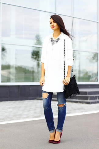 A white open cardigan and blue ripped jeans will showcase your sartorial self. Dark red suede pumps will add a touch of polish to an otherwise low-key look.