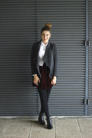 Choose a dark grey open cardigan and a oxblood velvet skater skirt for a lazy Sunday brunch. Elevate this ensemble with black leather ankle boots.