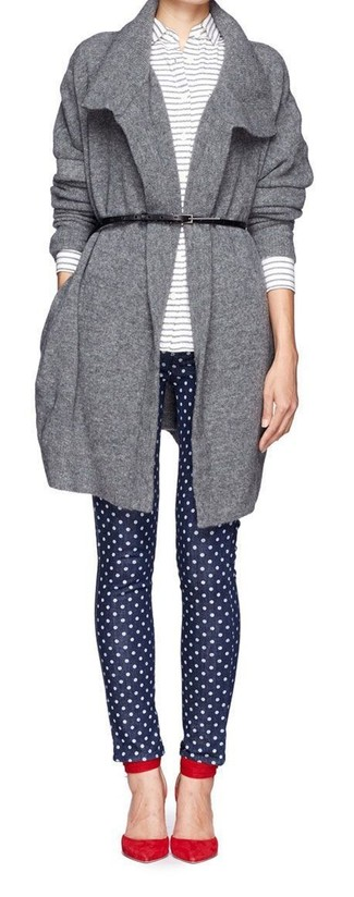 Pairing a grey open cardigan with navy polka dot skinny jeans is a comfortable option for running errands in the city. Red suede pumps will bring a classic aesthetic to the ensemble.
