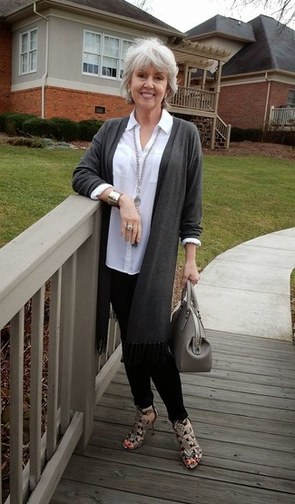 How to Wear a Grey Leather Tote Bag After 50: Wear a charcoal open cardigan with a grey leather tote bag to achieve new levels in your off-duty fashion game. For something more on the elegant side to round off this getup, complete this look with brown snake leather heeled sandals.