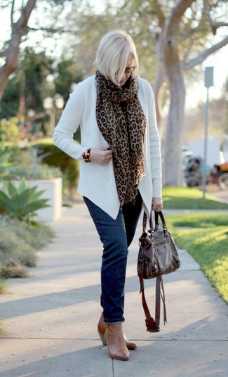 A white open cardigan and navy blue jeans are great staples that will integrate perfectly within your current looks. Tan leather ankle boots will instantly smarten up even the laziest of looks.