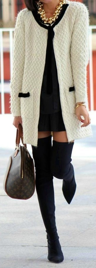 How to wear: white knit open cardigan, black long sleeve blouse, black pleated mini skirt, black suede over the knee boots
