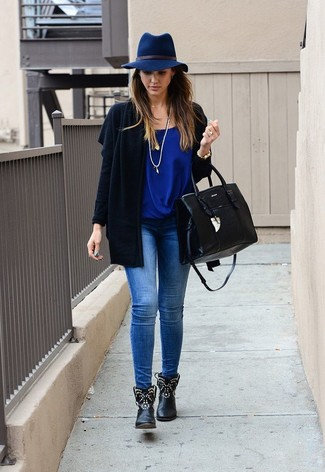 A black open cardigan and blue slim jeans is a great pairing worth integrating into your wardrobe. Play down the casualness of your look with black studded leather ankle boots. An outfit like this makes it easy to embrace weird transitional season.