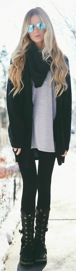 Team a black open cardigan with black leggings for a comfy-casual look. For a more relaxed take, rock a pair of rain boots.