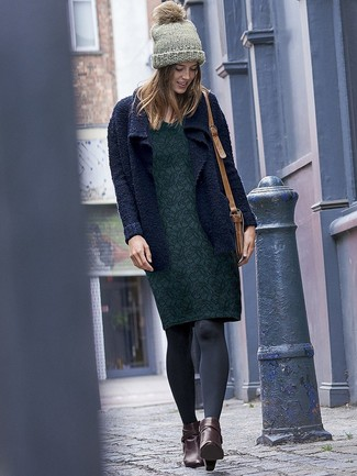 How to wear: navy knit open cardigan, dark green floral sheath dress, dark brown leather ankle boots, tan leather crossbody bag