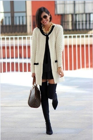 How to wear: white and black knit open cardigan, black shift dress, black suede over the knee boots, dark brown print leather tote bag