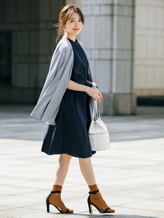 How to wear: grey open cardigan, navy shirtdress, black suede heeled sandals, white leather bucket bag