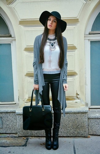 A grey open cardigan and black leather leggings is a nice combination to add to your casual repertoire. Black leather booties will add elegance to an otherwise simple look.