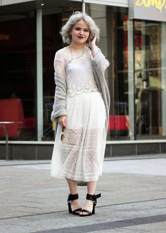 A grey open cardigan and a white pleated lace midi skirt feel perfectly suited for weekend activities of all kinds. Polish off the ensemble with black leather heeled sandals.