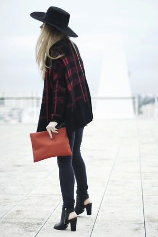 Master the effortlessly chic look in a dark red open cardigan and charcoal skinny jeans. Lift up your ensemble with black cutout leather ankle boots. And when you have one of those gloomy autumn days, sometimes only a kick-ass getup like this one can get you out the door in the morning.