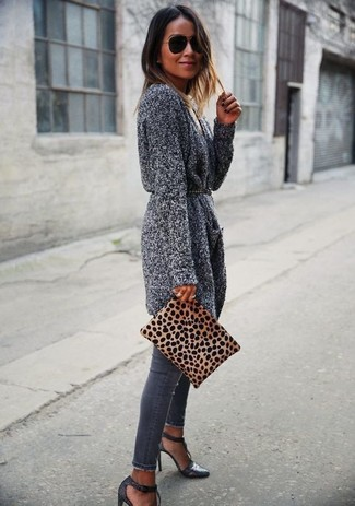 Opt for comfort in a grey knit open cardigan and a black studded leather belt. A pair of charcoal leather heeled sandals adds more polish to your overall look. We guarantee this combo is the just the remedy to dreary fall afternoons.