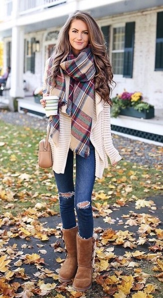 How to wear: beige knit open cardigan, navy ripped skinny jeans, brown uggs, beige leather crossbody bag
