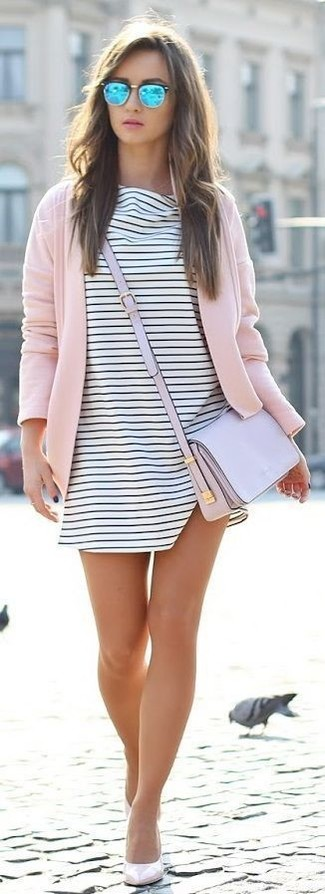 Make a dusty pink open cardigan and a white and black striped swing dress your outfit choice for an effortless kind of elegance. Let's make a bit more effort now and grab a pair of nude leather pumps.