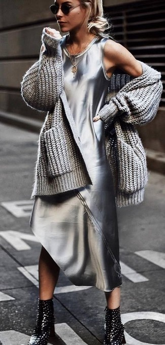 How to wear: grey knit open cardigan, silver tank dress, black studded leather ankle boots, black sunglasses