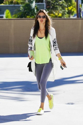 How to wear: white and black geometric open cardigan, green-yellow tank, grey leggings, yellow canvas low top sneakers