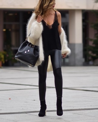 How to wear: white fluffy open cardigan, black silk tank, black leather leggings, black suede ankle boots