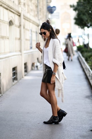 How to wear: white knit open cardigan, white tank, black leather mini skirt, black studded leather ankle boots