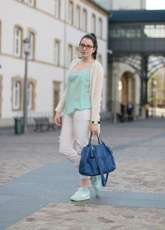 Consider pairing a beige knit open cardigan with white destroyed skinny jeans to create a great weekend-ready look. Consider mint low top sneakers as the glue that will bring your look together. An outfit like this is perfect for winter-to-spring weather.