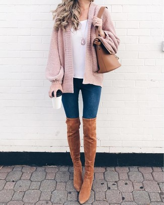 How to Wear Tan Suede Over The Knee Boots: Team a pink knit open cardigan with navy skinny jeans to achieve a day-to-day look that's full of charm and character. To give your overall ensemble a more sophisticated aesthetic, why not complement your outfit with tan suede over the knee boots?