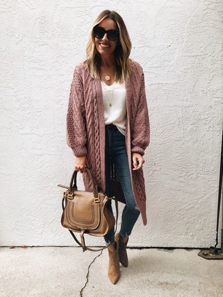 A pink knit open cardigan and Dsquared2 women's Paint Splatter Londean Jeans will convey a carefree, cool-girl vibe. Brown suede ankle boots will instantly elevate even the laziest of looks. Loving this one, especially for spring.