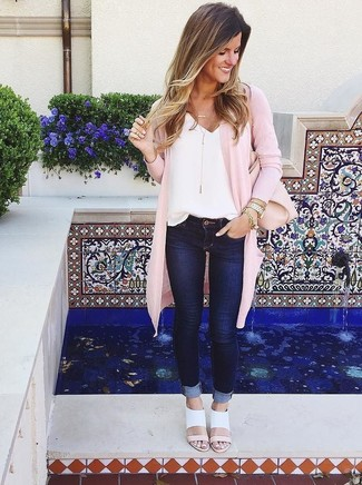 How to wear: pink open cardigan, white silk tank, navy skinny jeans, white leather heeled sandals