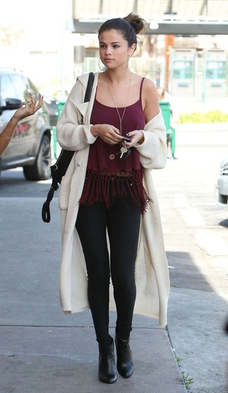 How to wear: beige knit open cardigan, burgundy fringe tank, black skinny jeans, black leather ankle boots