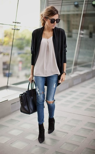 Pairing a black open cardigan with blue destroyed skinny jeans is a comfortable option for running errands in the city. Black suede booties will bring a classic aesthetic to the ensemble.