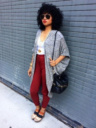 Wear a grey open cardigan with dark red jogging pants for a lazy Sunday brunch. Make brown canvas heeled sandals your footwear choice to instantly up the chic factor of any outfit.