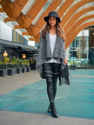 A grey knit open cardigan and a black fringe leather crossbody bag will convey a carefree, cool-girl vibe. Up the ante of your outfit with black leather lace-up ankle boots. Rest assured, this combination is the answer to all of your transeasonal style problems.