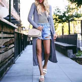 Consider teaming a grey open cardigan with light blue ripped denim shorts for an easy to wear look. A pair of white leather flat sandals will integrate smoothly within a variety of combinations. Ideal for summertime, this combination will gain quite a few likes on the 'gram too.