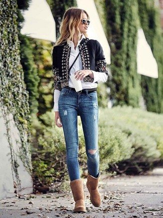 How to Wear Blue Ripped Skinny Jeans: This off-duty combo of a black embellished open jacket and blue ripped skinny jeans is extremely easy to throw together without a second thought, helping you look chic and prepared for anything without spending too much time digging through your closet. Brown uggs can easily dial down a smart ensemble.