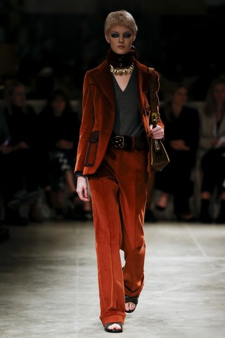 This combo of an orange corduroy blazer and orange corduroy wide leg pants will attract attention for all the right reasons. A pair of black woven leather heeled sandals will integrate smoothly within a variety of combos. If you feel uninspired by your transitional weather fashion options, this outfit just might be the inspiration you are looking for.