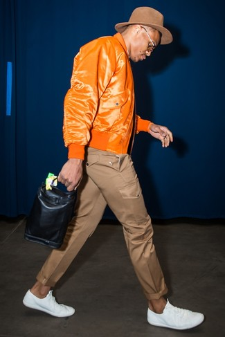 How to wear: orange bomber jacket, brown chinos, white leather low top sneakers, brown wool hat