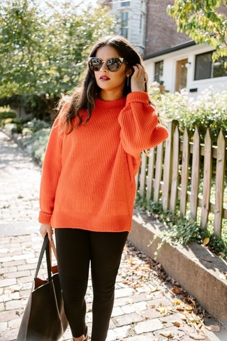 How to wear: orange knit cable sweater, black leggings, black leather tote bag, black sunglasses