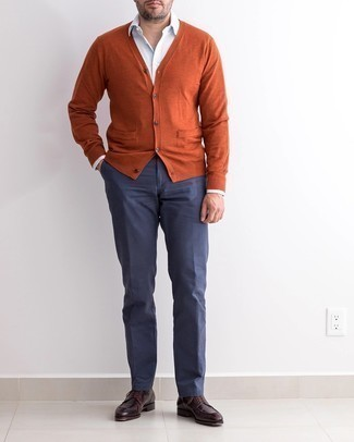 Cardigan Outfits For Men: Extremely stylish, this off-duty combination of a cardigan and navy chinos will provide you with variety. Perk up your outfit by finishing off with dark brown leather derby shoes.