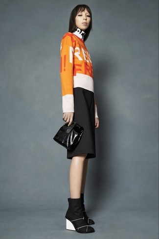 How to wear: orange print crew-neck sweater, black culottes, black suede wedge ankle boots, black leather clutch