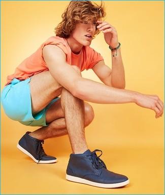 How to wear: orange crew-neck t-shirt, aquamarine shorts, navy high top sneakers