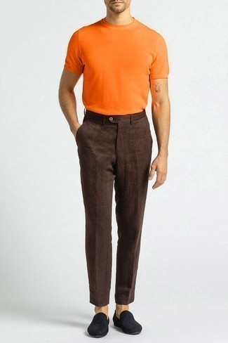 1200+ Outfits For Men In Their 30s: One of the coolest ways for a man to style out an orange crew-neck t-shirt is to team it with dark brown linen chinos in a relaxed combo. Breathe a dash of refinement into your look by rounding off with a pair of black canvas loafers. Wondering what you should wear as you head into your 30s? This outfit is a practical illustration.