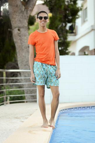 How to wear: orange crew-neck t-shirt, light blue print shorts, black sunglasses