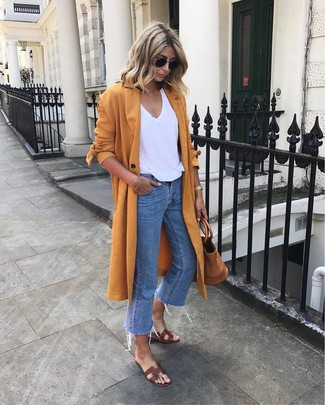 How to wear: orange duster coat, white v-neck t-shirt, blue jeans, dark brown leather flat sandals