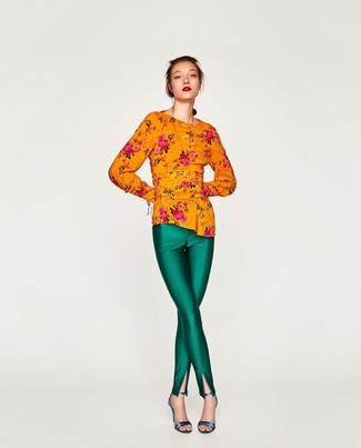 Green Skinny Pants Outfits: Rock an orange floral long sleeve blouse with green skinny pants for a casual level of dress. Complete your outfit with a pair of blue leather heeled sandals and off you go looking smashing.