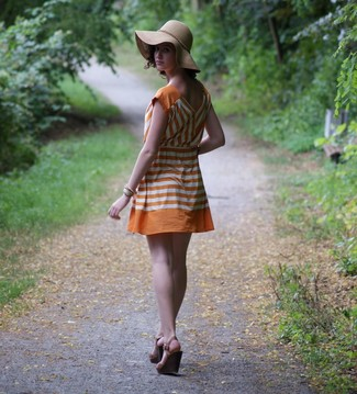 Stay stylish on busy days in an orange striped casual dress. Take your outfit into a sportier direction with dark brown sandals. Stick with this one if you're hunting for a cool summertime getup.