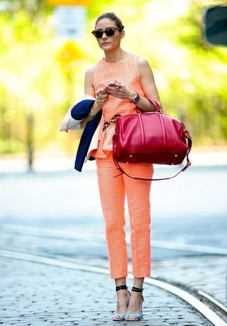How to wear: orange jumpsuit, light blue leather heeled sandals, red leather duffle bag, dark brown sunglasses