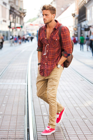 An orange plaid long sleeve shirt and khaki chinos are great staples that will integrate perfectly within your current looks. Go for a pair of hot pink low top sneakers for a more relaxed aesthetic.