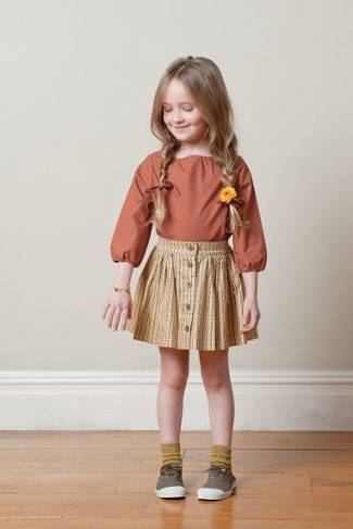 How to wear: orange long sleeve shirt, yellow skirt, brown sneakers, mustard socks